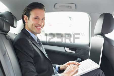 38131000-businessman-working-in-the-car